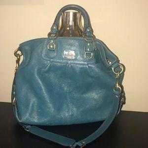 Used Coach handbag still with lots of wear